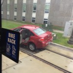 Car on tracks near Robert Street Station. Don't drive on tracks ... This is not a Streetcar.