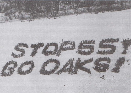 800 people protest the reroute in a field near the four bur oaks, March 1999