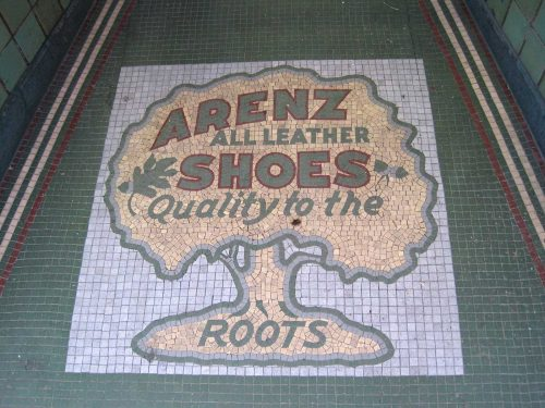 Metallic gold tile tree with red and green letters, Arenz All Leather Shoes Quality to the Roots, white background, green edges